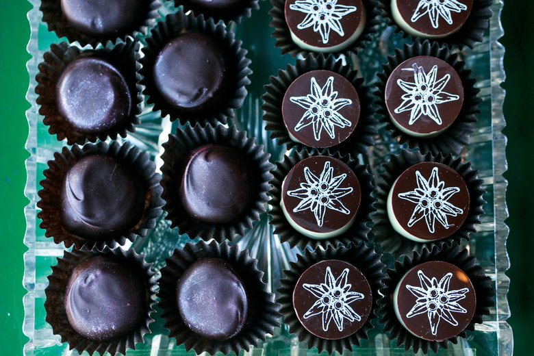 Boehm's Chocolates shop in Poulsbo, a branch of the Issaquah business, offers delicacies such as chipotle, left, and edelweiss truffles. (Erika Schultz/The Seattle Times)