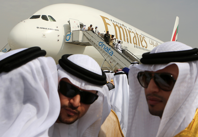 Emirati officials greet each other in front of an Emirates Airbus A380 on display during the 2013 Dubai Airshow. Emirates is the biggest customer for Airbus' double-decker superjumbo jet. (Kamran Jebreili/AP)