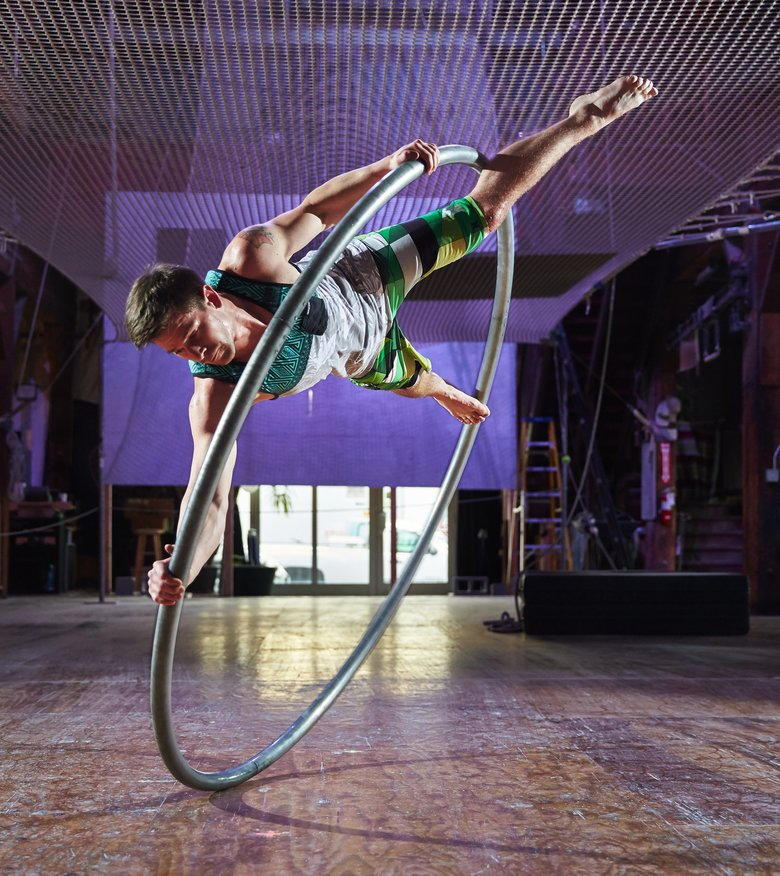 Coleton Stinson makes spinning on a Cyr wheel look easy. It's not. (Benjamin Benschneider/The Seattle Times)
