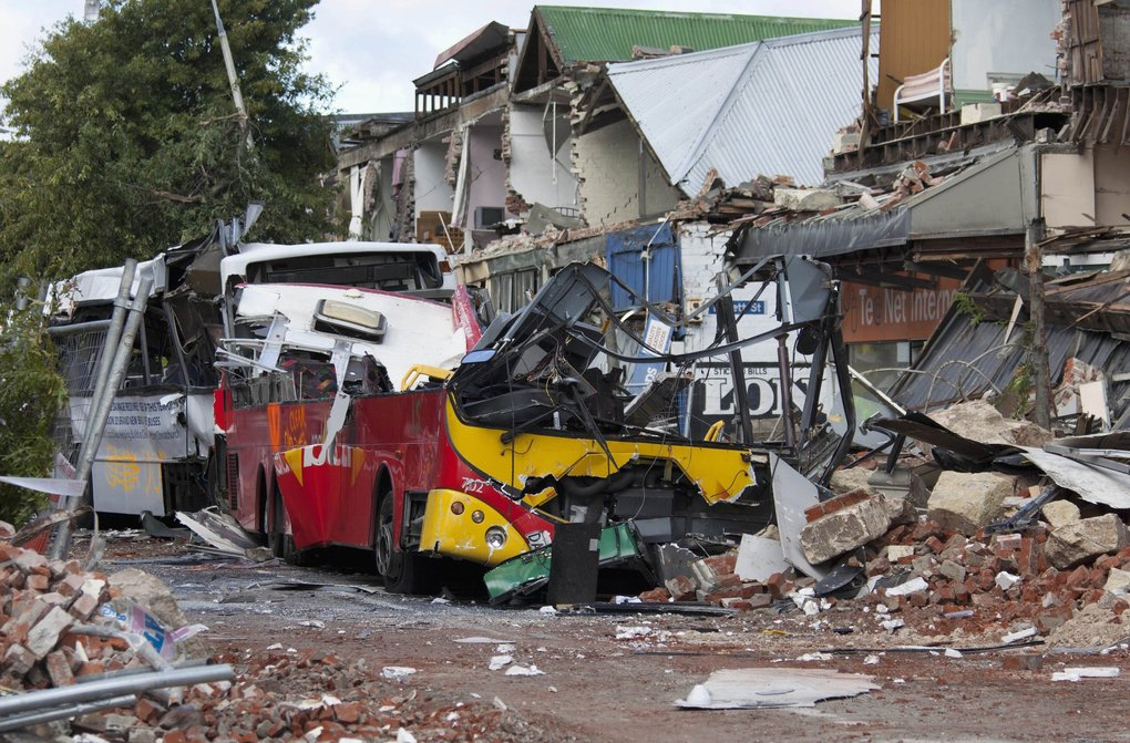 Wrecked buses are seen in rubble on Colombo Street, the main street of Christchurch February 24, 2011. (Simon Baker / Reuters)