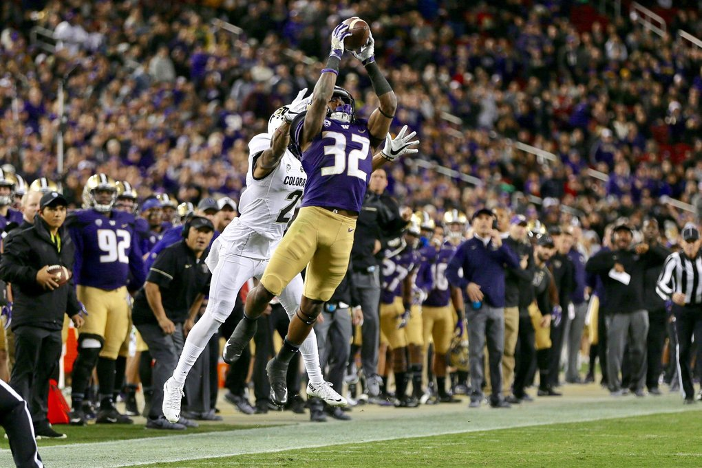Huskies linebacker Budda Baker intercepts a pass intended for Buffaloes wide receiver Devin Ross in the second quarter. Baker stepped out of bounds so the interception was nullified but it forced fourth down and a punt for the Buffaloes. (Johnny Andrews / The Seattle Times)