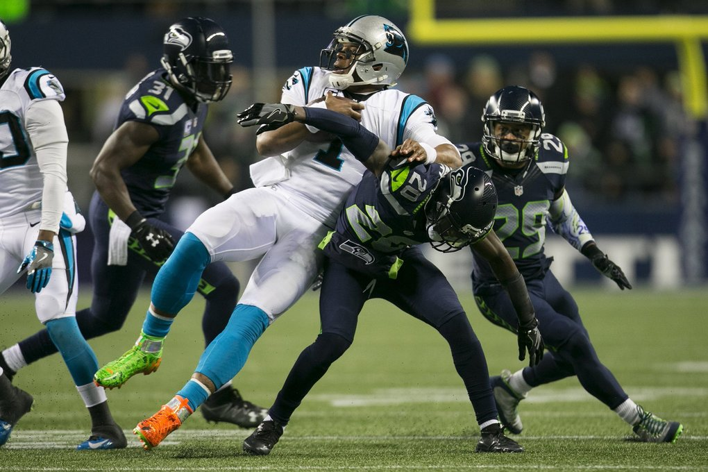 Carolina Panthers quarterback Cam Newton (1) is brought down by the Seahawks defense in the first quarter. (Johnny Andrews / The Seattle Times)