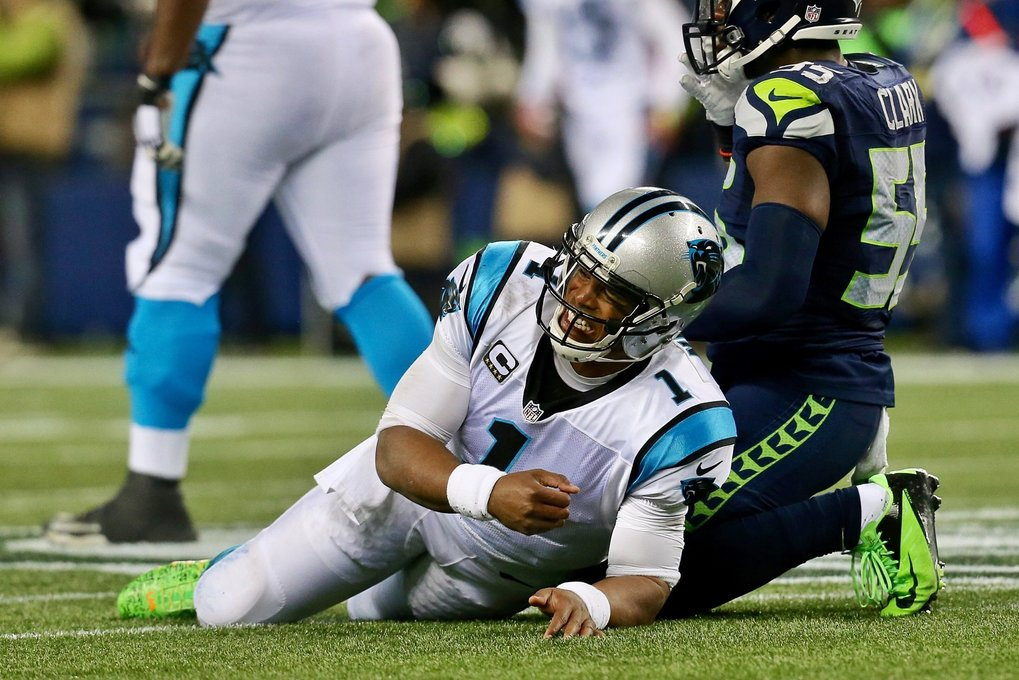 Panthers quarterback Cam Newton grimaces after taking a hard hit on an incomplete pass in the third quarter. (Johnny Andrews / The Seattle Times)