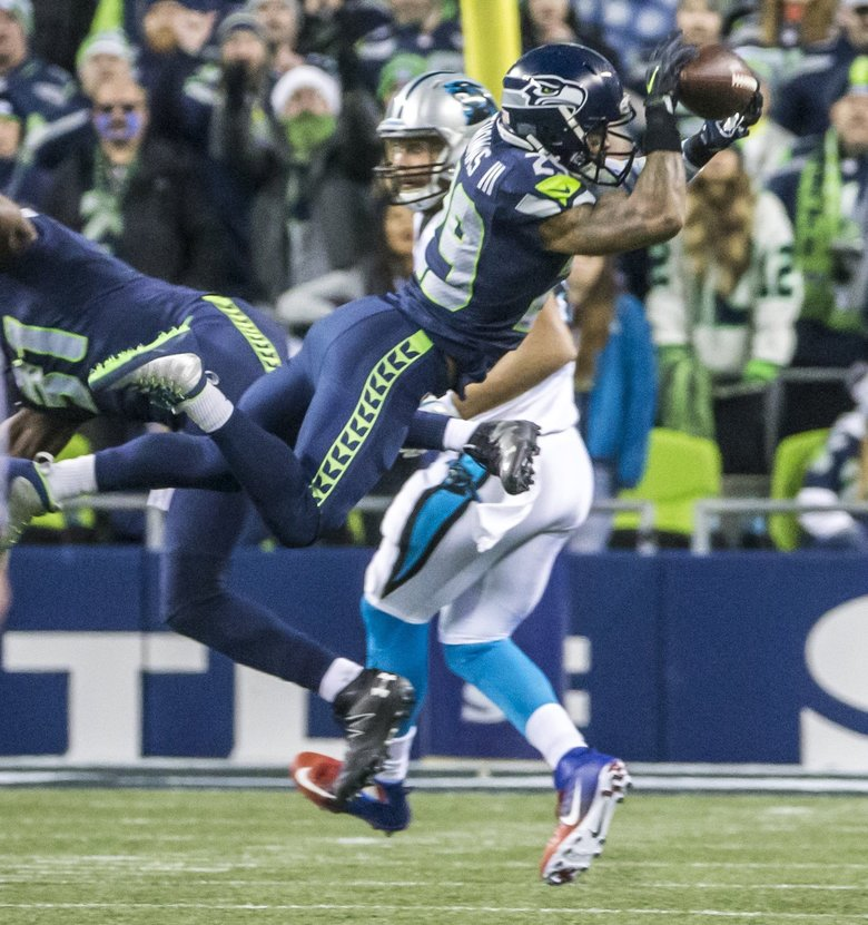 Seahawks free safety Earl Thomas almost intercepts Panthers tight end Greg Olsen but injures himself on the landing, and leaves the game in the second quarter. (Bettina Hansen / The Seattle Times)
