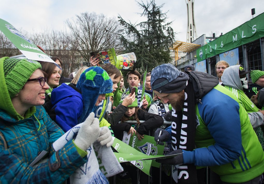 Seattle Sounders goalkeeper Stefan Frei signs autographs for fans after a Sounders march and rally to Fisher Pavilion to celebrate their first MLS Cup victory in downtown Seattle on Tuesday. (Lindsey Wasson / The Seattle Times)