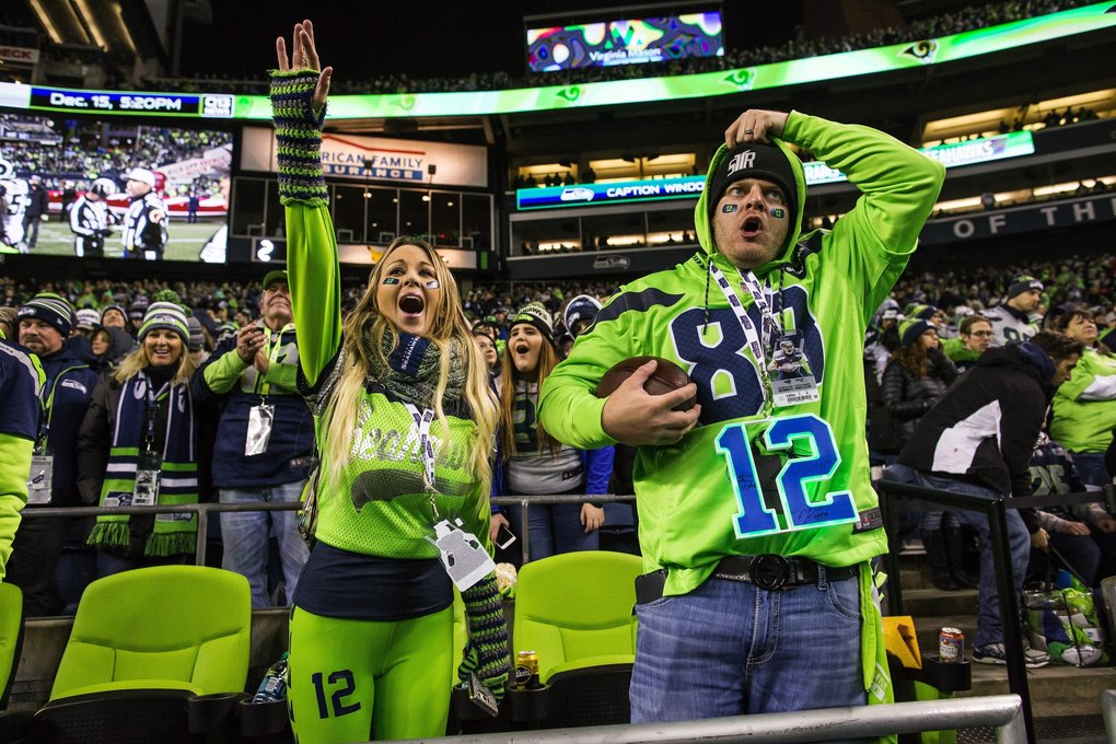 Seahawks fans cheer their team on to a victory over the Rams on Thursday. (Dean Rutz / The Seattle Times)
