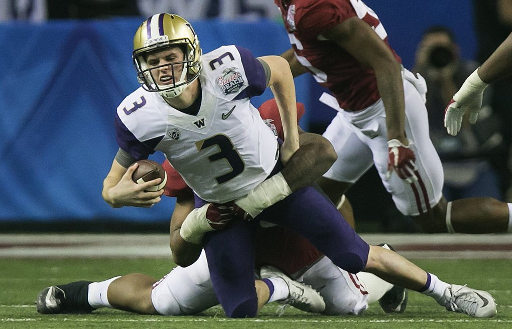 Washington Huskies quarterback Jake Browning (3) is sacked by Alabama Crimson Tide defensive lineman Jonathan Allen (93) during the fourth quarter. (Johnny Andrews / The Seattle Times)