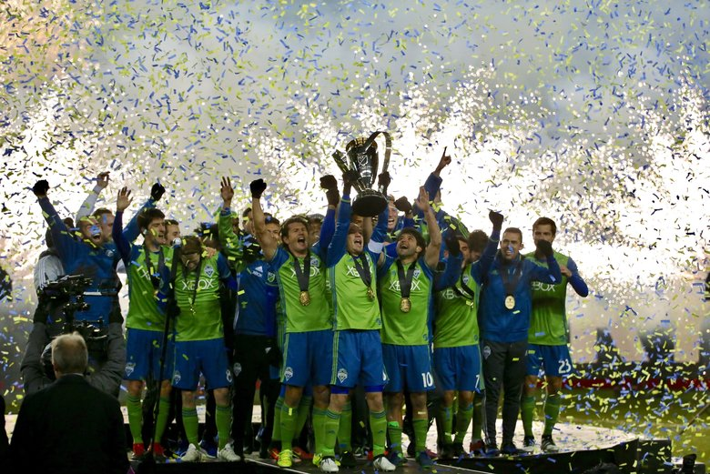 The Seattle Sounders celebrate their MLS Cup victory over Toronto in mid-December. (Johnny Andrews/The Seattle Times)