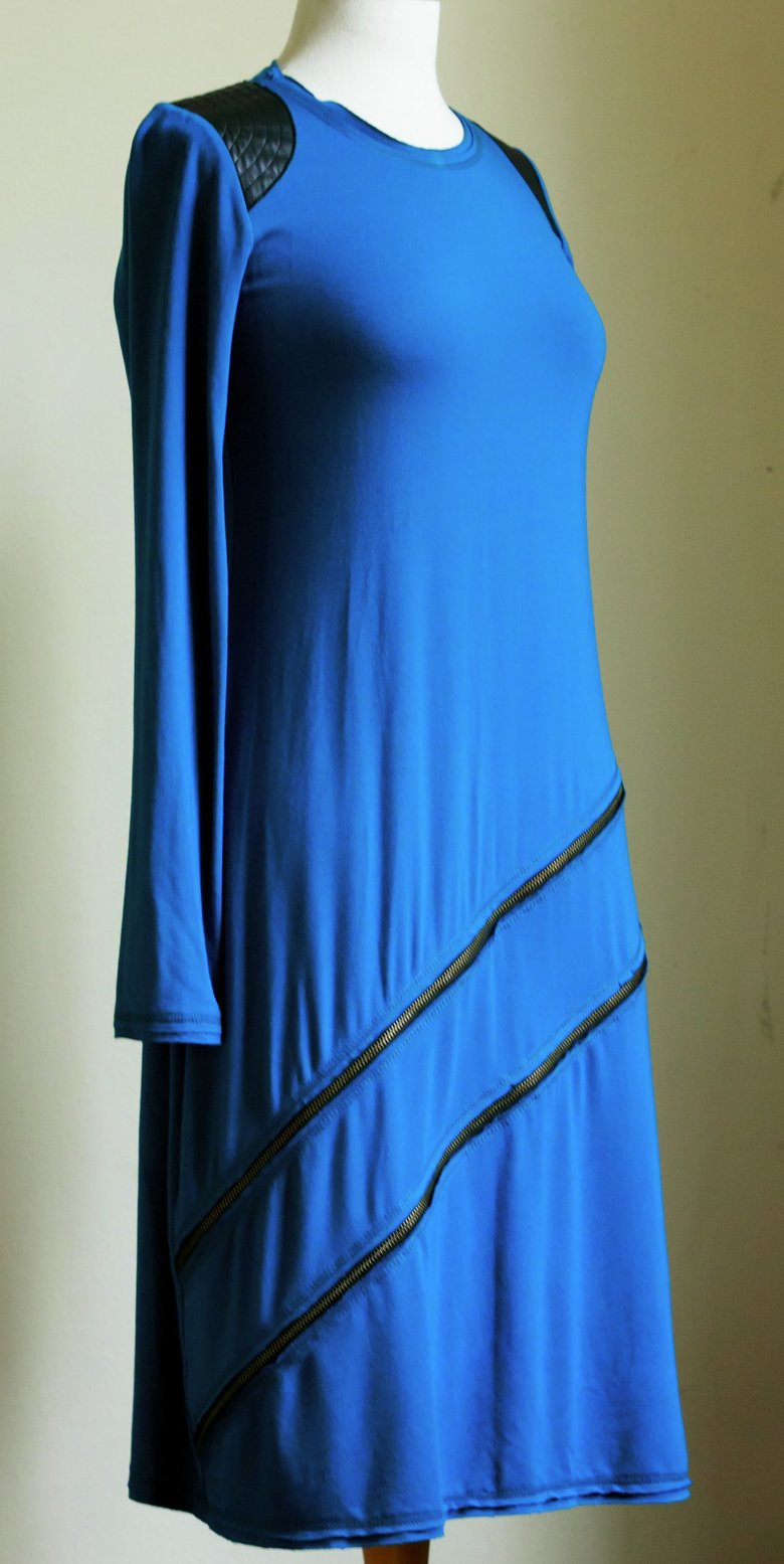 A dress by Woodinville-based designer Sabika Makhdoom features leather trim and decorative zippers.  (Erika Schultz/The Seattle Times)