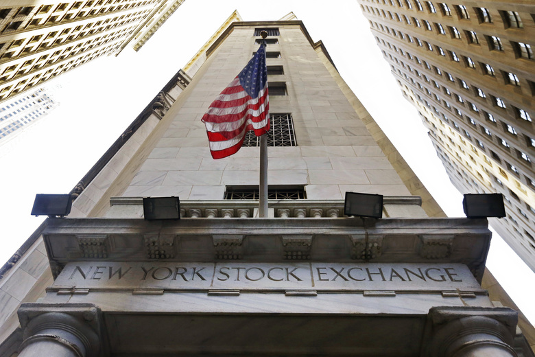 FILE – In this Friday, Nov. 13, 2015, file photo, the American flag flies above the Wall Street entrance to the New York Stock Exchange. More gains in Goldman Sachs and Chevron helped pull the Dow Jones industrial average to another record high even as other indexes were flat to lower in early trading Thursday, Dec. 1, 2016.  (AP Photo/Richard Drew, File)