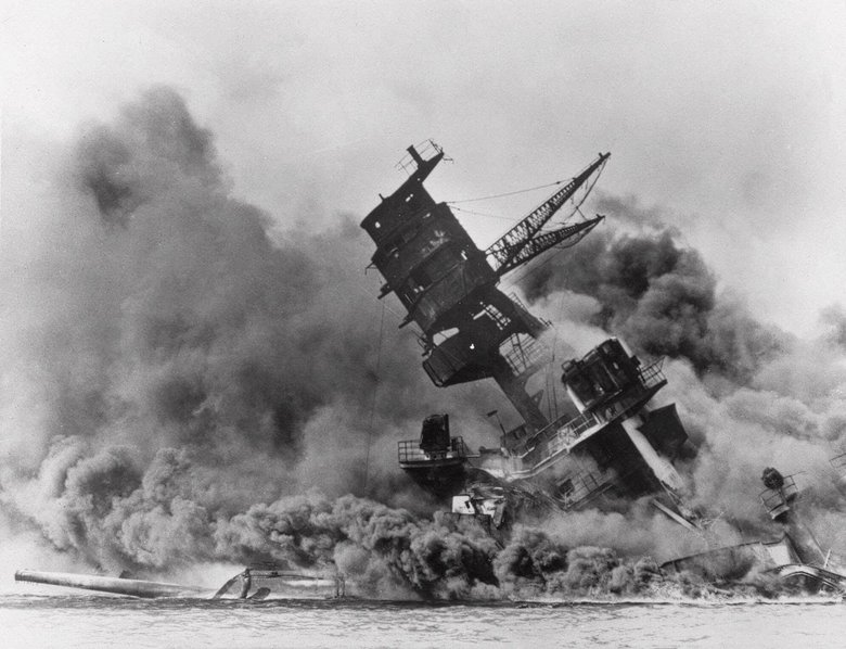 The battleship USS Arizona sinks during the attack on Pearl Harbor, which brought the U.S. into World War II. (Anonymous/The Associated Press)