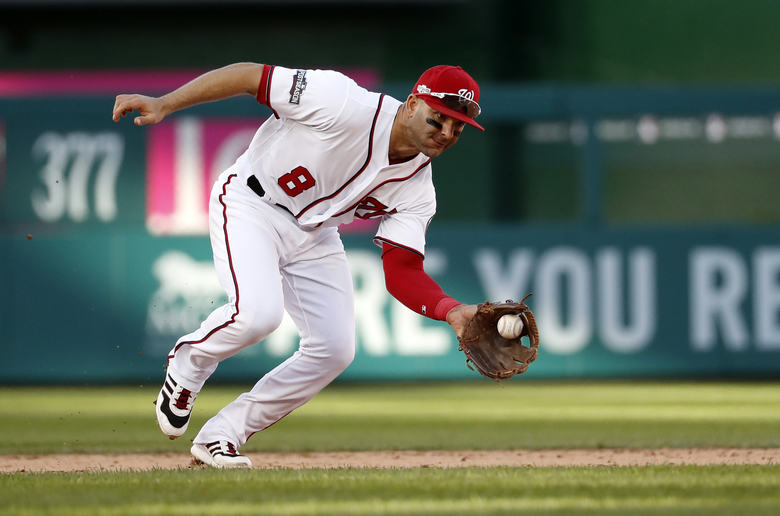 FILE- In this Oct. 9, 2016, file photo, Washington Nationals shortstop Danny Espinosa (8) fields a ground ball during Game 2 of baseball's National League Division Series against the Los Angeles Dodgers in Washington. The Los Angeles Angels have acquired shortstop Espinosa from the Washington Nationals for two minor league pitchers. (AP Photo/Alex Brandon, File)