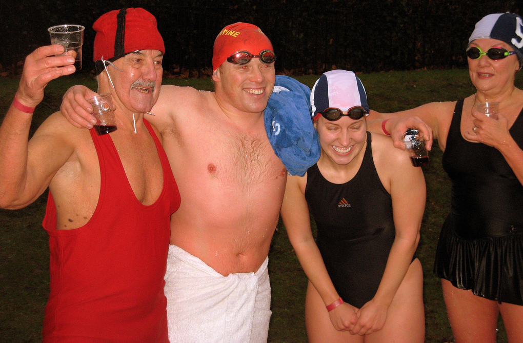 Shivering Christmas-morning swimmers thaw out with glasses of port after the annual Peter Pan Cup race in London's Hyde Park. (Brian J. Cantwell  /The Seattle Times, 2007)