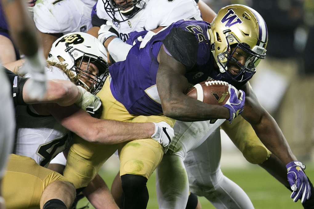 Washington Huskies running back Lavon Coleman (22) rushes for a 5-yard gain in the second quarter. The Washington Huskies faced off against the Colorado Buffaloes in the Pac-12 championship game on Friday, December 2, 2016, at Levi's Stadium in Santa Clara, California. (Johnny Andrews/The Seattle Times)