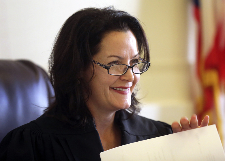 Hamilton Common Pleas Court Judge Leslie Ghiz presides over court Tuesday, Nov. 29, 2016, in Cincinnati. Ghiz was selected Tuesday to preside over the retrial of former University of Cincinnati police officer Ray Tensing on murder and voluntary manslaughter charges in the July 2015 shooting of Sam DuBose. (Liz Dufour/The Cincinnati Enquirer via AP)