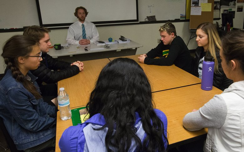 "Roosevelt High students in Michael Magidman's class during stress-reduction ""Rider Time,"" named after the school's Roughrider mascot. (Ellen M. Banner/The Seattle Times)"