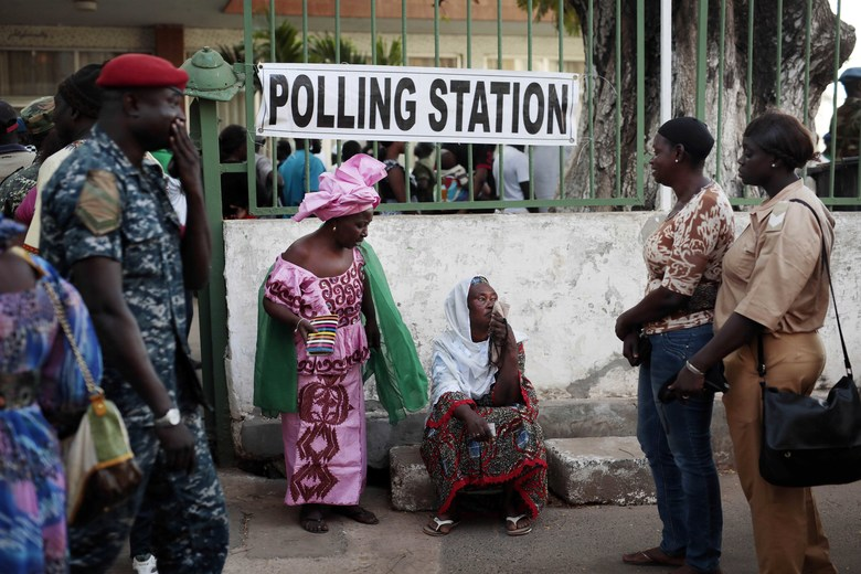 Gambians wait to cast their vote at a polling station in Banjul, Gambia, Thursday Dec. 1, 2016. Voters in the tiny West African nation of Gambia cast marbles Thursday in an election widely expected to keep the country's ruler of more than two decades in power despite a unified effort by the opposition. (AP Photo/Jerome Delay)
