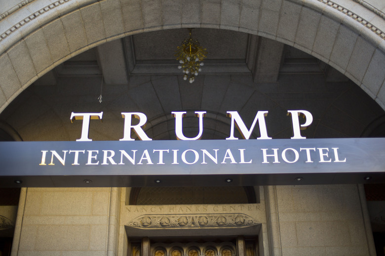 FILE – This Monday, Sept. 12, 2016, file photo, shows the exterior of the Trump International Hotel in downtown Washington. Several experts in government contract law say that President-elect Donald Trump will have to give up his stake in his prized Washington, D.C. hotel if he wants to be president. (AP Photo/Pablo Martinez Monsivais, File)
