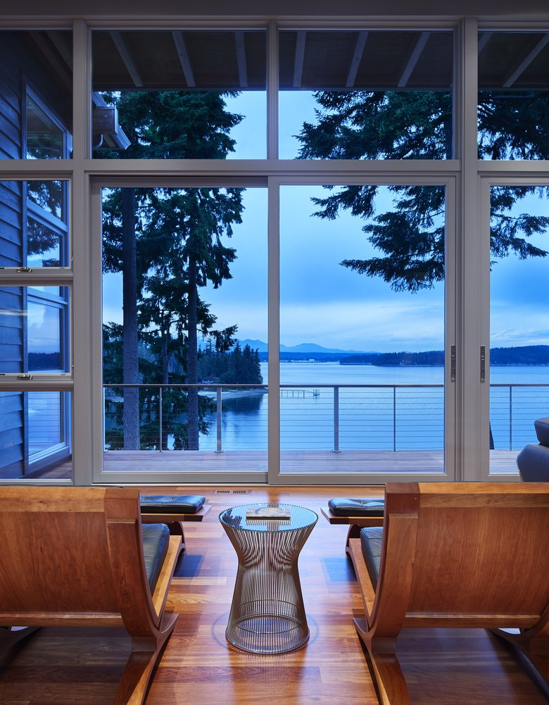 """Thirteen-foot-high ceilings in the living area create space for a wall of view-capturing windows. """"Now there are really big views, and the ceiling's not in the way,"""" architect Bernie Baker says. (Benjamin Benschneider/The Seattle Times)"""