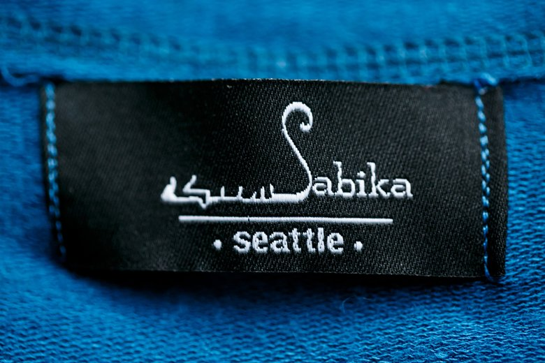 Woodinville-based designer Sabika Makhdoom's logo on the label of one of her designs.  (Erika Schultz/The Seattle Times)