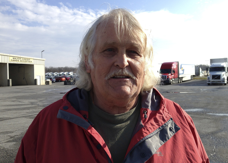 Truck driver Bill Varnado of Dallas, Ga., talks at a truck stop along Interstate 81 in Hagerstown, Md., on Wednesday, Dec. 7, 2016. He says he opposes Congress suspending a requirement for truckers to take two nights off to rest after a work week of up to 75 hours. He says the rule ensures that drivers get needed sleep. (AP Photo/David Dishneau)