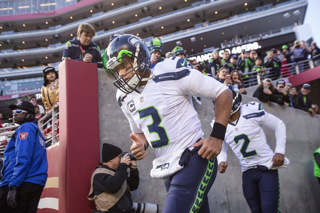 Seahawks quarterback Russell Wilson heads out on to the field for Sunday's game. (Dean Rutz / The Seattle Times)