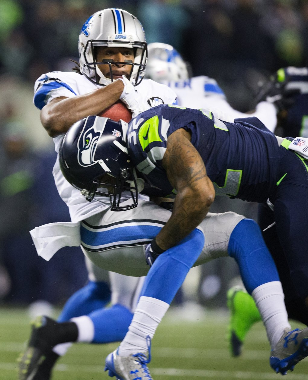 Seahawks strong safety Jeron Johnson tackles Detroit Lions wide receiver Andre Roberts for a kick return of only 19 yards in the fourth quarter.  (Lindsey Wasson / The Seattle Times)