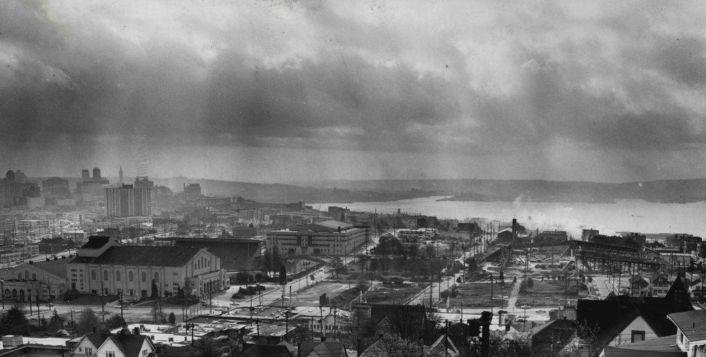 The site for the Century 21 Exposition is seen in the foreground of this view south from Queen Anne Hill in 1960. Construction on the Coliseum is seen at the right. To the left are the Ice Arena, the Civic Auditorium, the Memorial Stadium and the Field Artillery Armory, all of which will be on the exposition grounds. (Roy Scully / The Seattle Times)