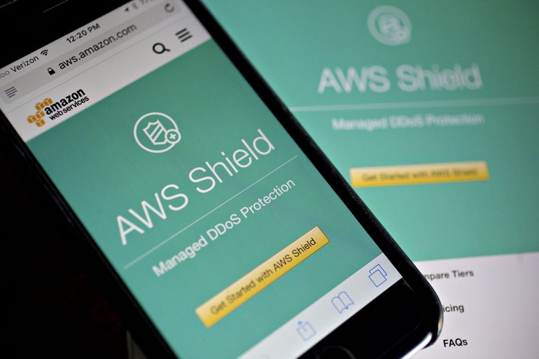 The Amazon.com Inc. Amazon Web Services (AWS) Shield website is displayed on an Apple Inc. iPhone and iPad. (Andrew Harrer / Bloomberg)