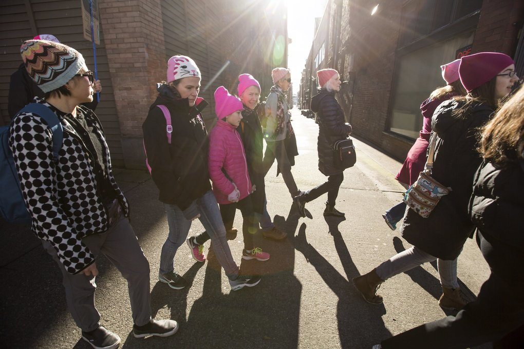 "Pink ""pussy hats"" colored the day at the Womxn's March on Seattle.   (Bettina Hansen / The Seattle Times)"