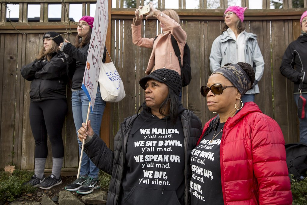 "Josalyn Conley of Renton, left, and Minerva Humphrie of Seattle, self described ""BFFs,"" stand together before the Womxn's March on Seattle. ""People of color live in fear constantly,"" said Conley. ""What Trump has created is a new normal for people who have not had to live that way. Now people can relate to what my fight is and what my fight has been.""   (Bettina Hansen / The Seattle Times)"