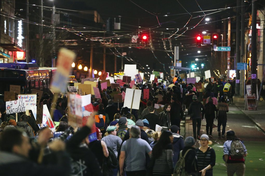 People march up Broadway on Capitol Hill on Sunday. (Ken Lambert / The Seattle Times)