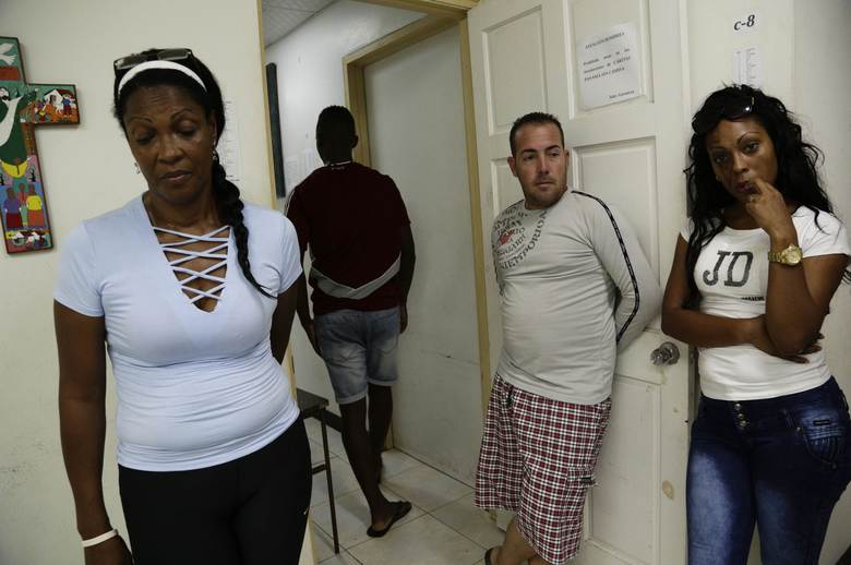 "A group of Cuban migrants talk about their future at a shelter in Panama City, Thursday, Jan. 12, 2017. President Barack Obama announced Thursday he is ending a longstanding immigration policy that allows any Cuban who makes it to U.S. soil to stay and become a legal resident. The repeal of the ""wet foot, dry foot"" policy is effective immediately. (AP Photo/Arnulfo Franco)"