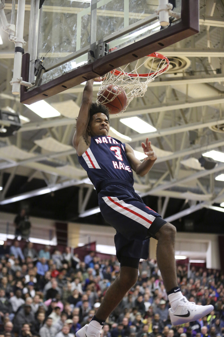 Nathan Hale's PJ Fuller II dunks against Oak Hill Academy during a high school basketball game at the 2017 Hoophall Classic on Monday. (Gregory Payan/AP)