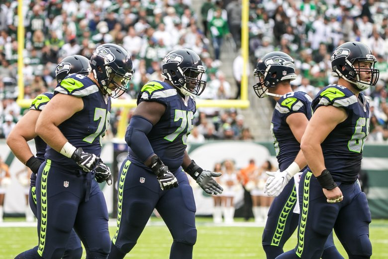 Seahawks offensive linemen Bradley Sowell, Germain Ifedi and Justin Britt take the field in the first half as the Seattle Seahawks take on the New York Jets at MetLife Stadium in East Rutherford New Jersey Sunday, October 2, 2016.