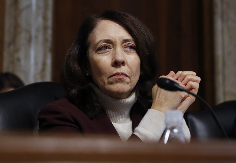 The Senate Energy and Natural Resources Committee's ranking Democrat, Sen. Maria Cantwell of Washington, listens as former Texas Gov. Rick Perry, Donald Trump's nominee to lead the federal Department of Energy, testifies on Capitol Hill in Washington. (Carolyn Kaster/AP)