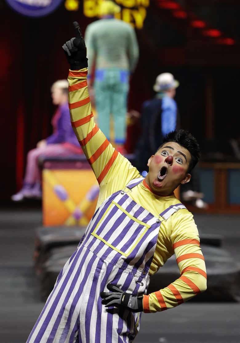 "A Ringling Bros. and Barnum & Bailey clown performs Saturday, Jan. 14, 2017, in Orlando, Fla. The Ringling Bros. and Barnum & Bailey Circus will end the ""The Greatest Show on Earth"" in May, following a 146-year run of performances. Kenneth Feld, the chairman and CEO of Feld Entertainment, which owns the circus, told The Associated Press, declining attendance combined with high operating costs are among the reasons for closing. (AP Photo/Chris O'Meara)"