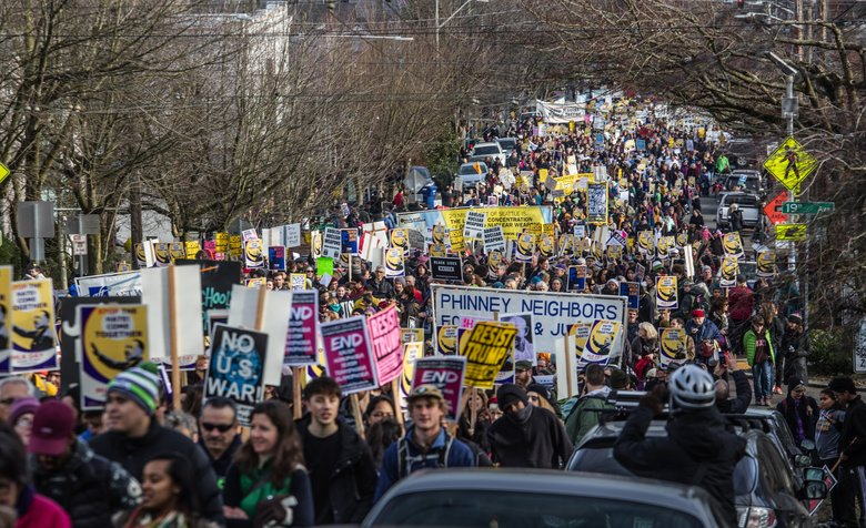 Thousands filled East Union Street after a Martin Luther King Jr. Day rally at Garfield High School to march to the Federal Building in downtown Seattle for another rally.  (Steve Ringman/The Seattle Times)