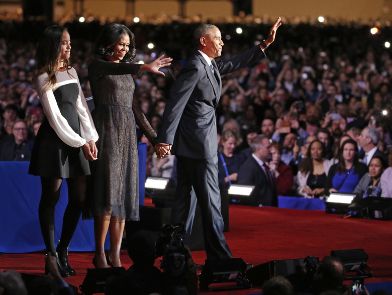 President Barack Obama waves as he is joined by First Lady Michelle Obama and daughter Malia Obama after giving his presidential farewell address at McCormick Place in Chicago, Tuesday, Jan. 10, 2017. (AP Photo/Nam Y. Huh)