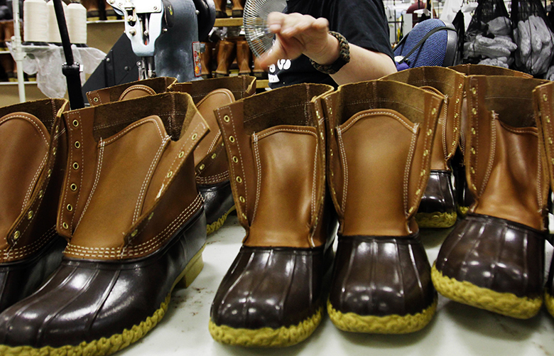 FILE – In this Dec. 14, 2011, file photo, Eric Rego stitches boots in the facility where LL Bean boots are assembled in Brunswick, Maine. L.L. Bean has a backlog of 51,000 orders for their famous boots that it intends to fill in the coming weeks. A company spokeswoman says harsh winter weather and the boot's ongoing popularity are driving demand. (AP Photo/Pat Wellenbach, File)