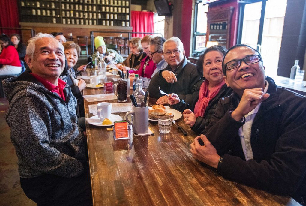 Trump supporters from around the Seattle area — including Eddie Liloc, at left, from University Place, and Patrick Luna, far right, from Seattle — watch the inauguration ceremonies at a meetup at a pub in Renton.  (Steve Ringman/The Seattle Times)