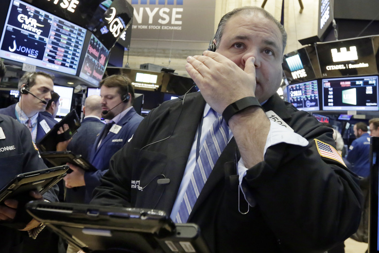 Trader Anthony Riccio works on the floor of the New York Stock Exchange, Thursday, Jan. 12, 2017. U.S. stocks moved broadly lower in early trading Thursday, giving back the market's gains from the day before. (AP Photo/Richard Drew)