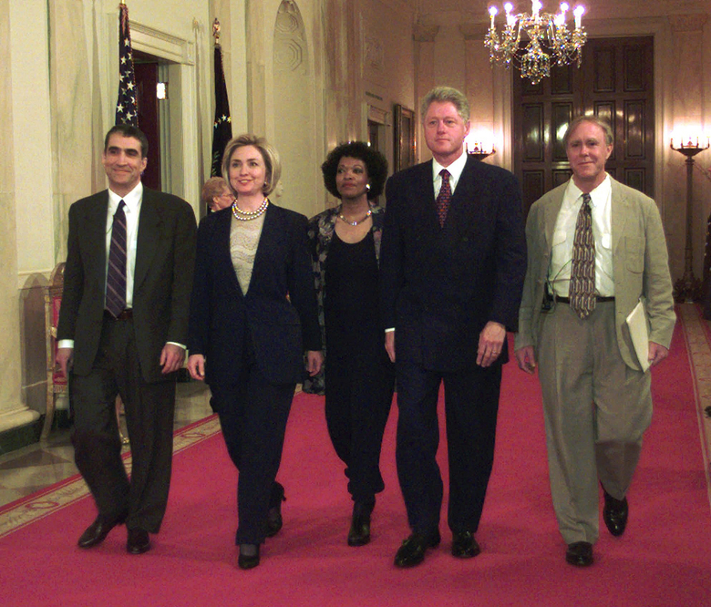 FILE – In this Wednesday, April 22, 1998 file photo, President Clinton and first lady Hillary Rodham Clinton walk down the State Floor hallway with Poets Laureate Robert Pinsky, left, Rita Dove, center, and Robert Haas, right, before the Millennium Evening Lecture at the White House in Washington. America's leading poets, including Pinsky and Dove, are averse to Donald Trump, and they have organized literary rallies in more than 30 states, which will be held on Sunday, Jan. 15, 2017, to say so. (AP Photo/Susan Walsh, File)