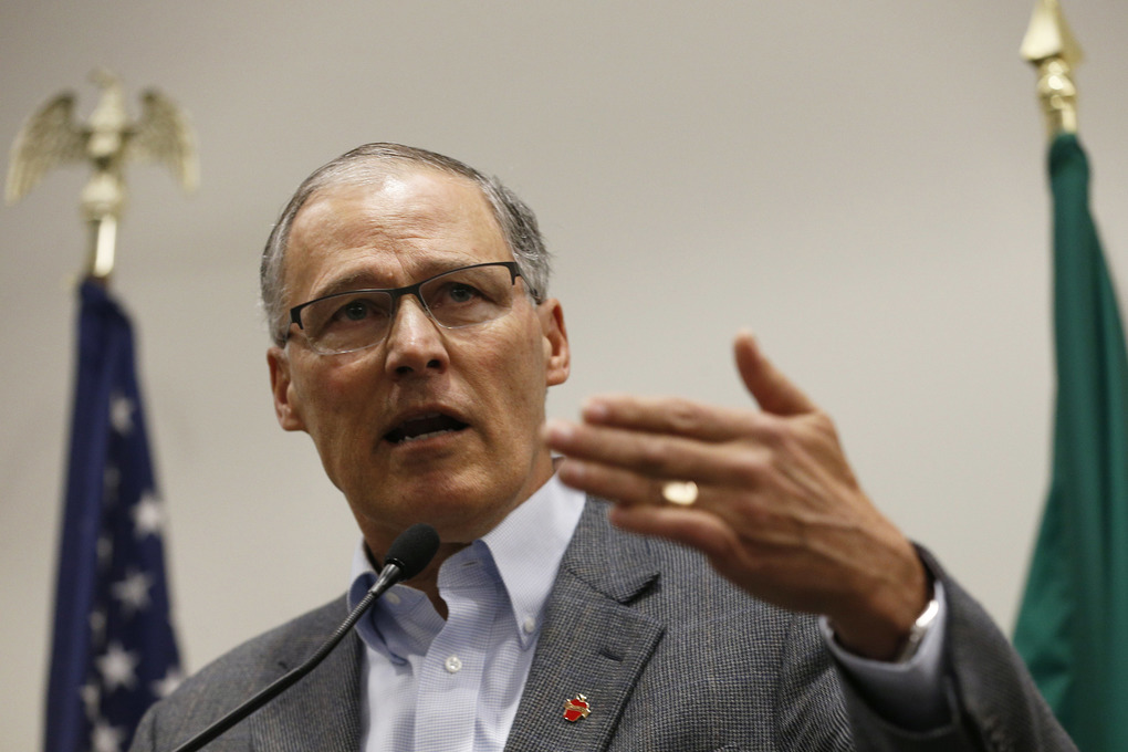 "Gov. Jay Inslee speaks to the media in the Airport Office Building at Seattle-Tacoma International Airport, Saturday, Jan. 28, 2017. Inslee blasted President Donald Trump's executive order banning people from certain Muslim-majority nations as ""unjustifiable cruelty."" (Logan Riely/The Seattle Times via AP)"