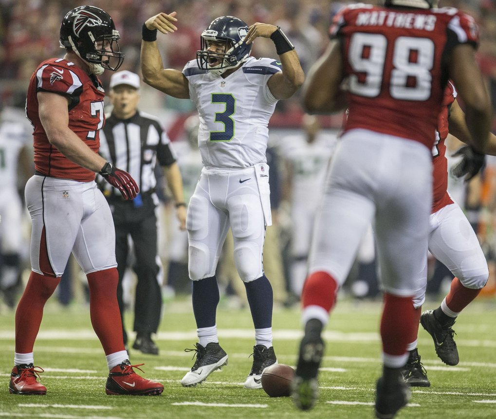 With time running out in the second quarter, Russell Wilson tries to get his team back to the line of scrimmage for one last play. Time ran out on the Seahawks who went into the locker room without any points. (Dean Rutz / The Seattle Times)