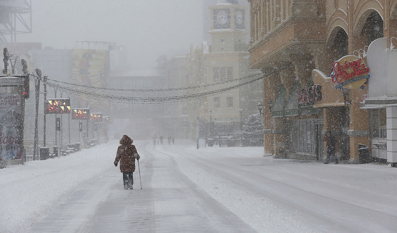 A pedestrian walks during a snowstorm on the Boardwalk in Atlantic City, N.J. Saturday Jan. 7 2017. Snow continues to fall across most of New Jersey as a winter storm makes its way up the coast. The heaviest snows are expected along the southern New Jersey coast, where a winter storm warning remains in effect.  (Ben Fogletto/The Press of Atlantic City via AP)