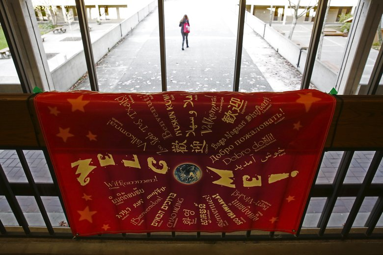 "A sign in the library that reads, ""Welcome!"" in many languages greets Edmonds Community College students. (Ken Lambert/The Seattle Times)"