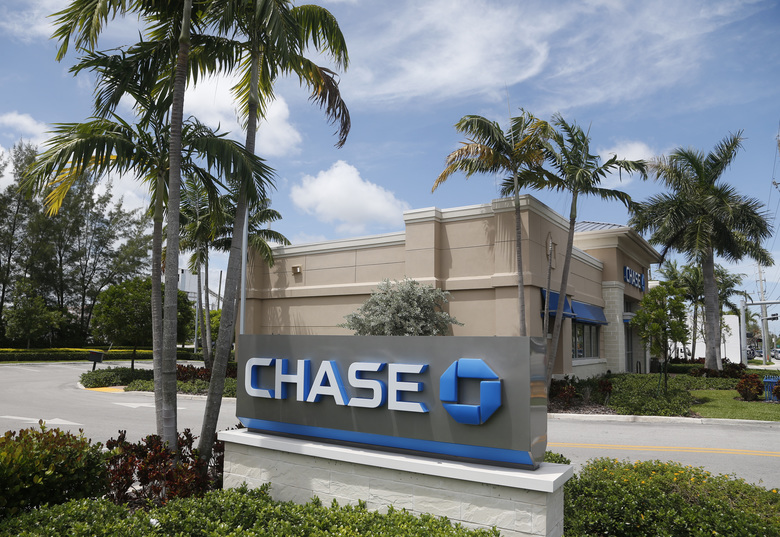 FILE – This Wednesday, Aug. 17, 2016, file photo, shows a Chase bank branch in North Miami Beach, Fla. On Friday, Jan. 13, 2017, JPMorgan Chase & Co. reports financial results. (AP Photo/Wilfredo Lee, File)