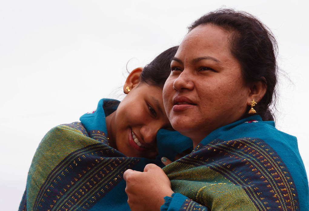 Prashana Biswa, 13, cuddles with her mother, Sunita, during their second day in the United States. They said it was colder in Seattle than they expected.
