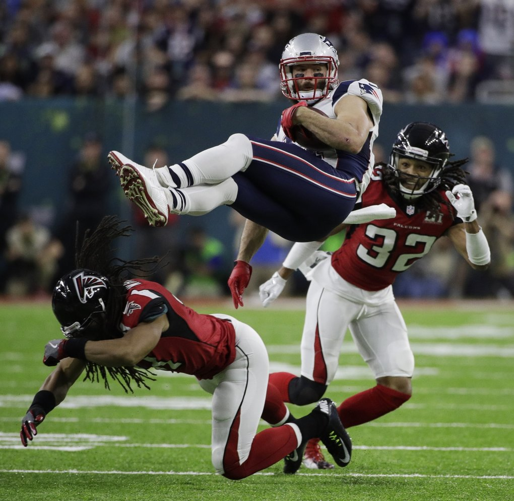 New England Patriots  Julian Edelman is upended by Atlanta Falcons  Philip  Wheeler 2a1c16fec